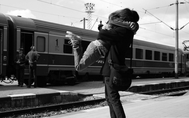 young-couple-at-the-train-station.jpg